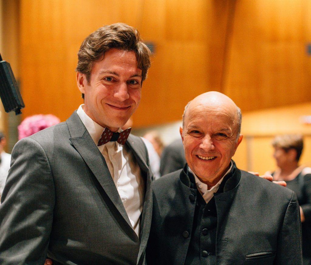 Maxime Goulet and Maestro Stephen Gunzenhauser, after the performance of Symphonic Chocolates at the Corning Museum of Glass, in New York, during the Endless Mountain Music Festival. Photo by Nadia Zheng, 2015