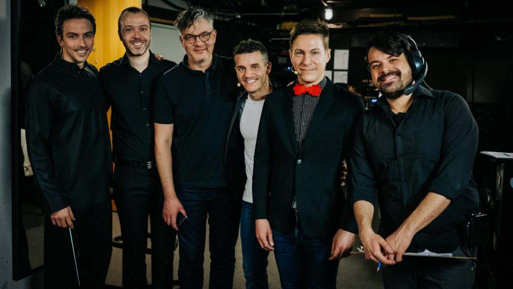 Maxime Goulet with Jean-Willy Kunz, Martin Gougeon, Patrice Bélanger and Simon Depot, for the performance of Citius, Altius, Fortius!, by the Montreal Symphony Orchestra, at the Maison Symphonique, in Montreal, in 2019. Photo by Michel Léonard
