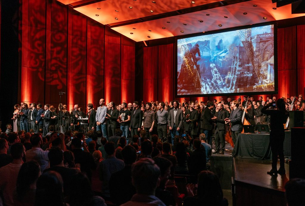 Maxime Goulet and Montreal video game composers with the Orchestre Métropolitain and conductor Dina Gilbert, for the Montreal Video Game Symphony concert, during the Montreal 375th anniversary celebrations, in Montréal, in 2017. Photo: François Goupil