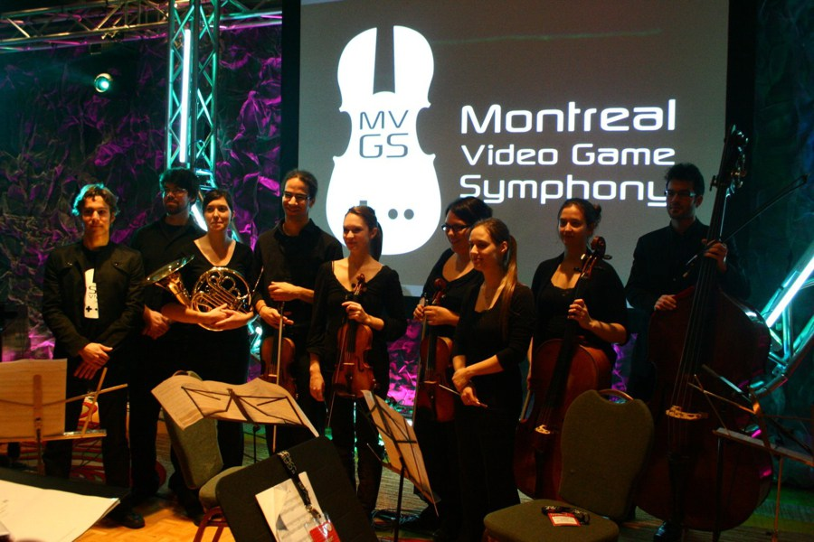 Maxime Goulet with Dina Gilbert and the Ensemble Arkea, during the performance of the music of the video game Dungeon Hunter 2, at the Montreal International Game Summit, in Montréal, in 2010.