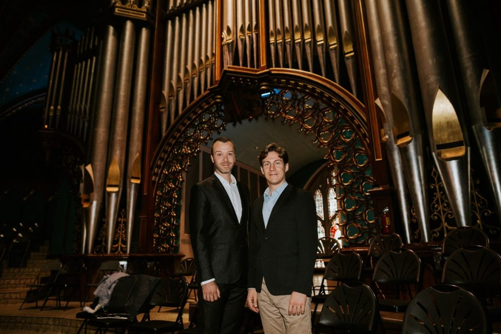 Maxime Goulet with Jean-Willy Kunnz, at Basilique Notre-Dame, in Montreal, for the premiere of the organ version of the olympic ouverture: Citius, Altius, Fortius! Photo by Nadia Zheng, 2016