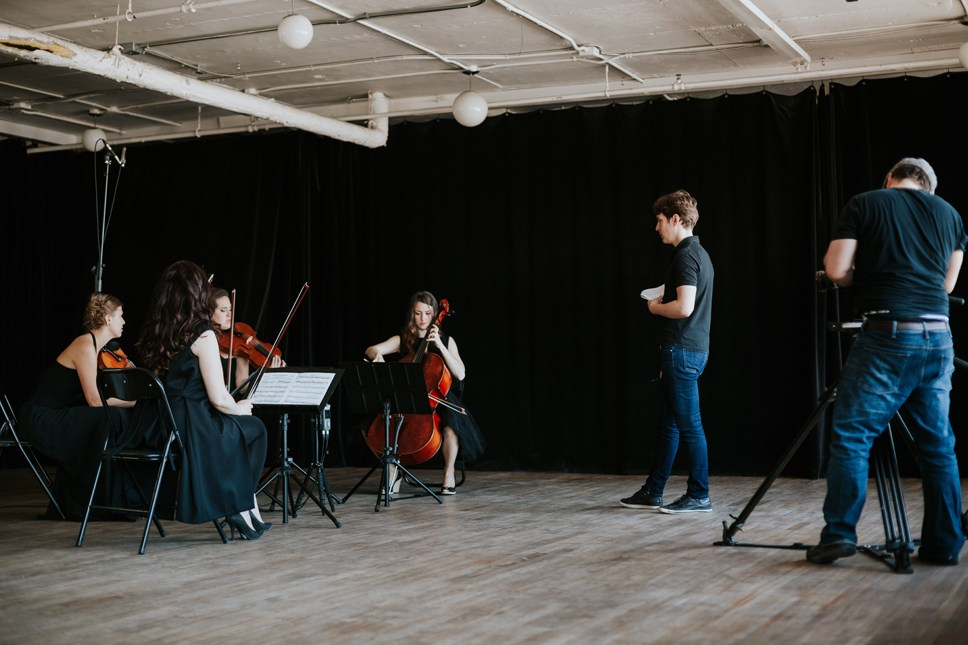 Maxime Goulet with 4Ailes string quartet and director Patrick Peris, for the shooting of the music video Caramel Chocolate, at La Cenne, in Montreal, in 2016. Photo: Nadia Zheng